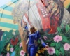 Dedican mural a Fefita La Grande en calle de Santiago