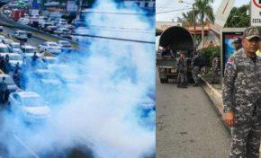 Policía dispersa a bombazos y palos pasajeros se apostaron en 27 de Febrero con Máximo Gómez; Fenatrano levanta paro